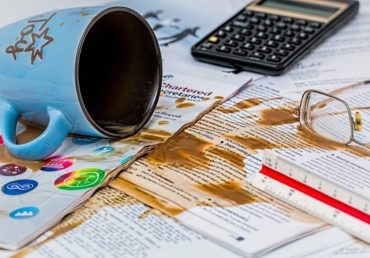 coffee spilt over papers